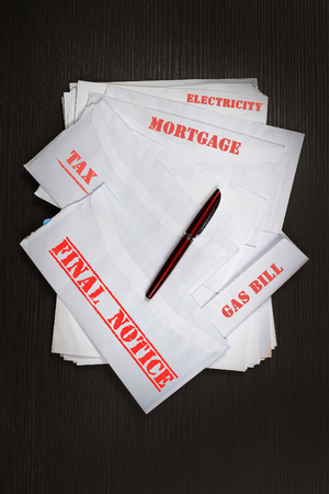 unpaid: Large pile of envelopes with unpaid bills for family home budget
