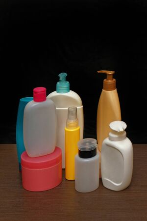 moisturiser: Colorful plastic toiletries bottles with closed lids Stock Photo