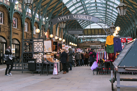 covent garden market: LONDON, UK - February 10: Famous Apple Market inside Covent Garden with people walking around and shopping in London, UK - February 10, 2015; The Apple Market is the permanent Market at Covent Garden that happens seven days a week.