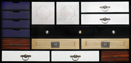 handles: Decorative retro cabinet drawers with metal handles Stock Photo