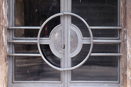 building entrance: Old building entrance door with dirty glass