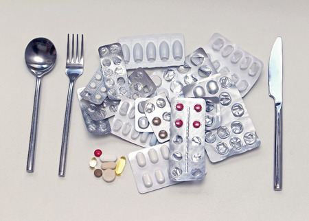 Pile of pills in blisters someone will have for lunch Imagens
