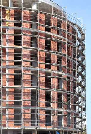 scaffolds: Construction of tall building with metal scaffolds