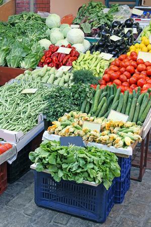 Fresh organic vegetables sold on small street market stall
