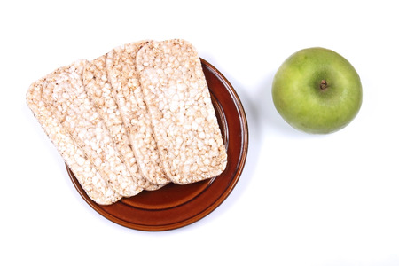 Rice cakes and green apple as healthy low calorie foods
