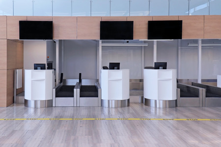 Empty airport check in counter with luggage conveyers 版權商用圖片