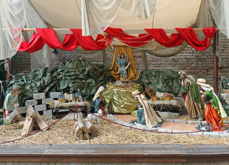 Birth of Jesus in native religious bible scene inside barn with decorative figurines
