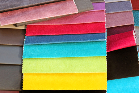 Fashion materials swatches background inside designer fabric store 写真素材