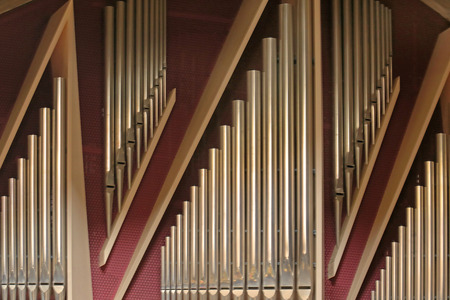 Pipe organ is a musical instrument that produces sounds by driving pressurized air through pipes. It is commonly used in places of worship.
