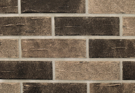 Grainy texture brown bricks wall pattern background Stock fotó