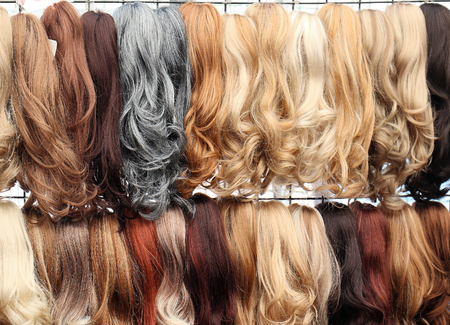 Glam female hair extensions in different colors and styles Imagens