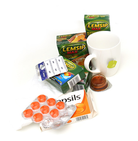 London, United Kingdom - January 23, 2016: Set of over the counter medicine and remedies for help with overcoming flu symptoms paracetamol, tea, pastilles...