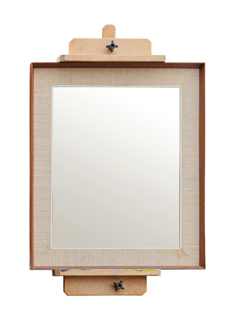 Vintage wooden easel with empty painting canvas on white background Фото со стока