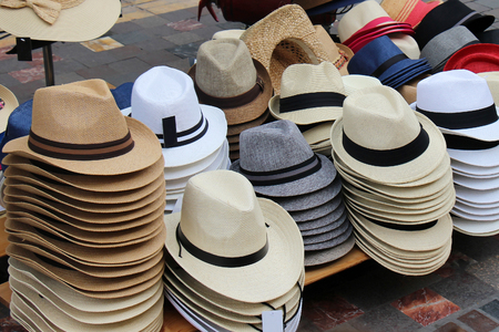 Retro summer straw hats stack sold on market