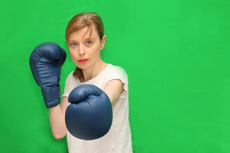 Young woman with boxing gloves prepared for tough match