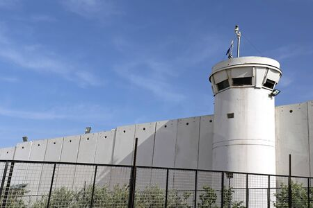Guard tower in front of border wall between Israel and Palestine near Bethlehem