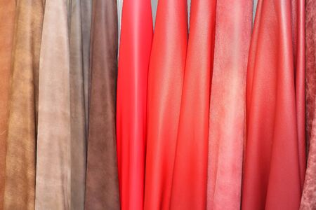 Colorful leather material samples hanging on a wall
