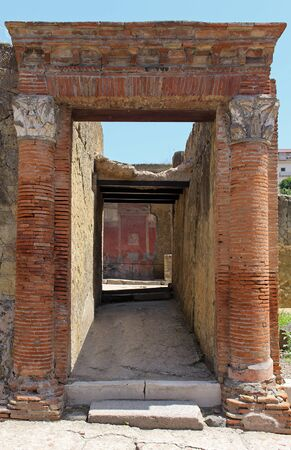 Old architecture tunnel entrance with red brick columns from Roman Empire time Stok Fotoğraf