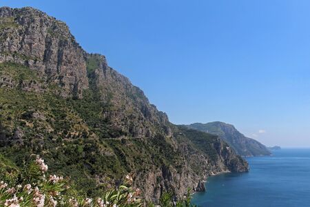 Tall mountains cliff next to Mediterranean sea coast Stok Fotoğraf