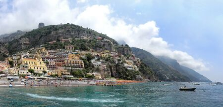 Tourists on famous Positano beach coast during summer