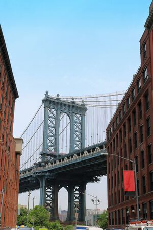 Famous Manhattan bridge in New York with old architecture shot from Brooklyn DUMBO neighborhood in New York