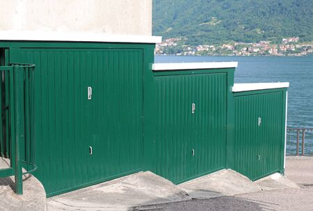Green closed garage doors on lake coast Stok Fotoğraf