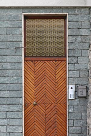 Retro closed wooden residential front door entrance