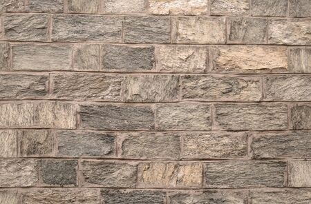 Old beige stone brick pattern background texture
