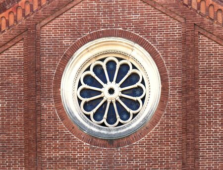 Vintage circle window exterior on brick wall texture facade