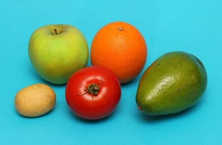 Fresh organic fruits and vegetables on blue background Stok Fotoğraf