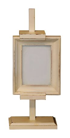 Retro wooden easel with empty small painting frame isolated on white