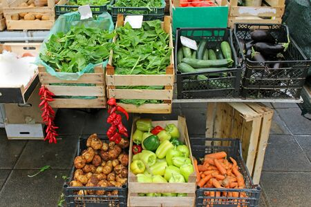 Wooden crates of fresh organic vegetables sold on market