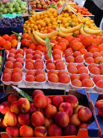 Fresh organic fruits piles sold on market Фото со стока - 137802879