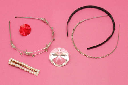 Sparkling hairstyle beauty accessories on pink background
