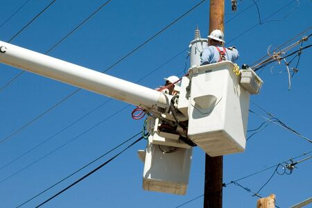 power lines: men at work on power lines