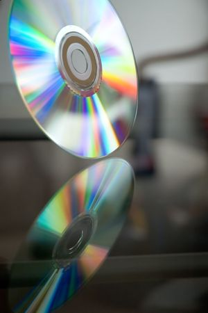 groundbreaking: Compact disc and its reflection Stock Photo