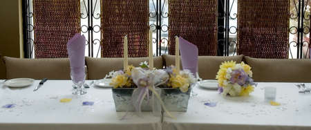 an elegantly dressed table setting front view