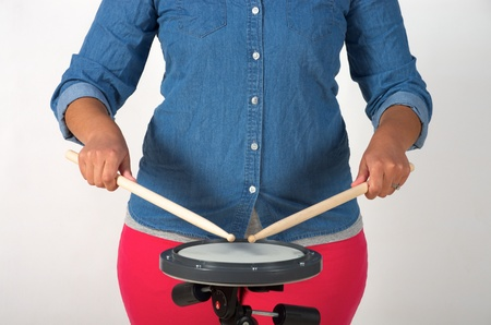 Matched drumstick grip with drum pad Stok Fotoğraf