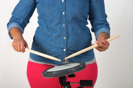 grip: Traditional drumstick grip with drum pad
