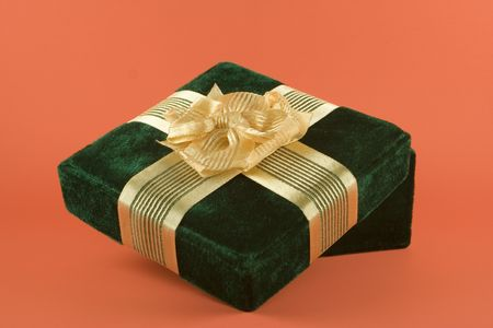 Green Gift on Melon Background Stock Photo - 646711