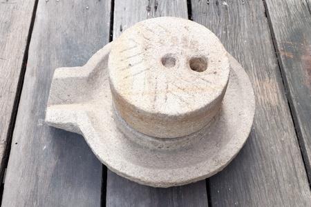 millstone: Millstone on wood floor