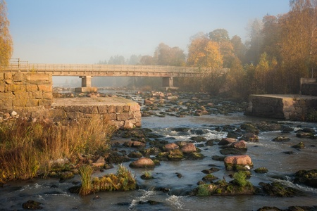 Rocky river in autumn mist photo