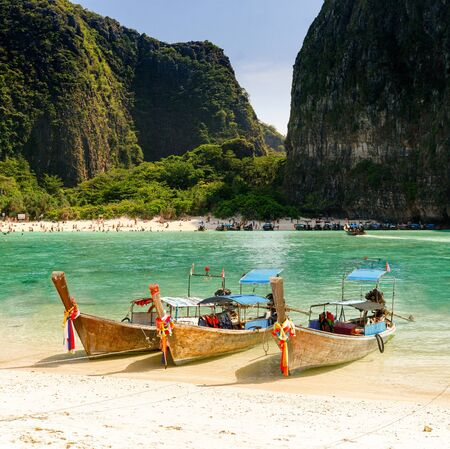 Long Tail Boats on Island in Thailand photo