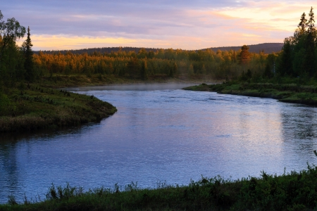 Steaming river on a very bright night in Finnish Lapland Stock Photo