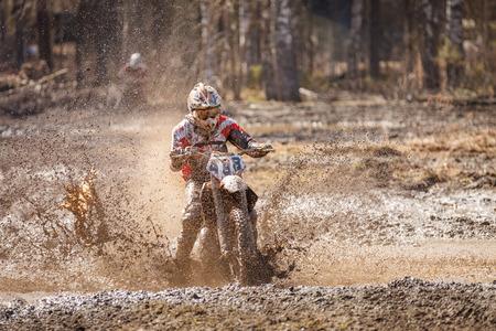 Motocross racer Stock Photo - 30559359