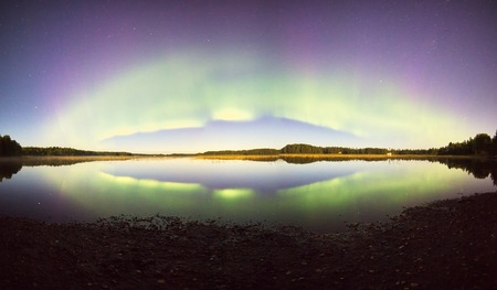 ionosphere: Northern lights with reflection on the lake at night.