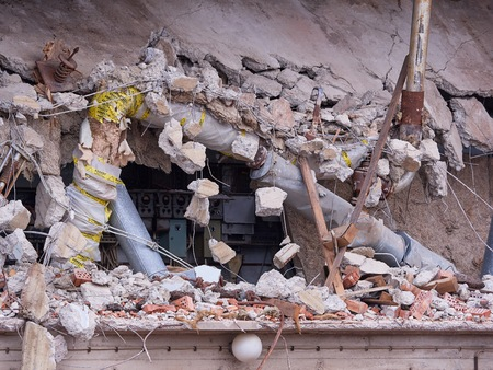Destroyed building wall at demolition site.