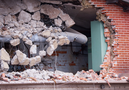 Hole in the wall of wrecked building at demolition site.