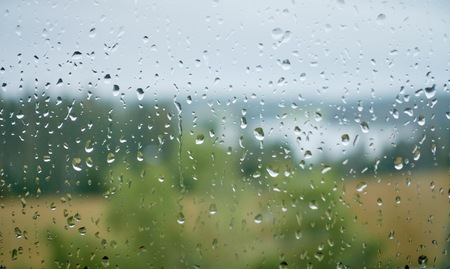 Water drops on wet window glass after the rain ona a rainy summer day.