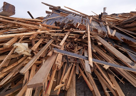 Pile of wooden planks at demolition site ready for hauling away for the recycling. Stock Photo